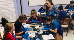 Middle School Students Study Bovine Eyeballs in Science Lab